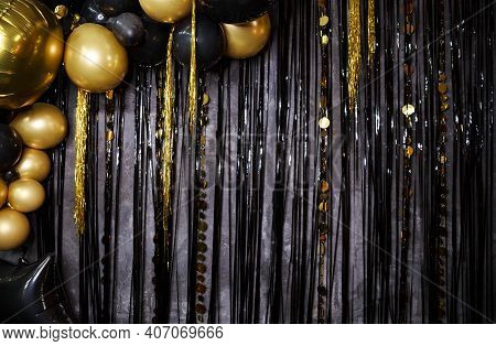 Shiny Gold, Black Balloons. New Year Baubles, Glossy Sparkles. Decoration Party Concept On Black Bac