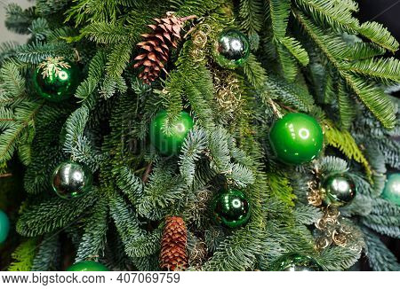 Beautiful Christmas Tree With Colorful Baubles And Illuminated Garland. Fir Tree Decorated With Chri