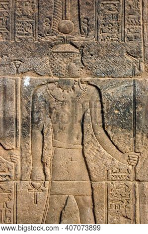 Carving Of The Ancient Egyptian King Deity Amun Ra Holding An Ankh In His Right Hand. Carving On A W