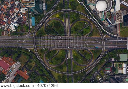 Top Down Overhead Aerial View Of Large Multi Lane Roundabout In Jakarta, Indonesia Large Traffic Jun