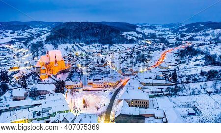 Biertan, Romania. Saxon Village With The Fortified Church In Transylvania, Frozen Winter Night.