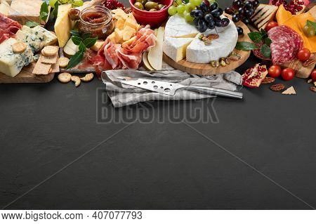Appetizers Table. Cheese, Fuits And Meat Board