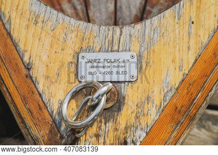 Bled, Slovenia, October 2020: Manufacturer's Sign On An Old Boat On Lake Blaysko In Slovenia