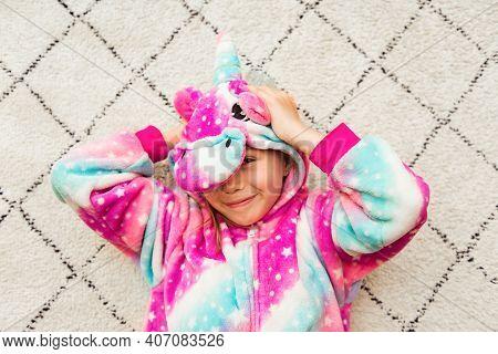 Cute Girl In Pink Kigurumi Unicorn Pyjamas Costume