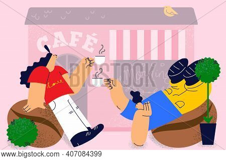 Coffee Shop, Cafeteria, Drinking Hot Drinks Concept. Young Couple Sitting On Summer Veranda Of Cafe