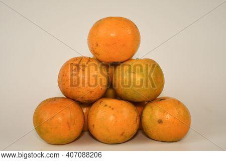 A Plie Of Sweet Orange On White Background