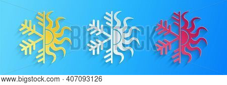 Paper Cut Hot And Cold Symbol. Sun And Snowflake Icon Isolated On Blue Background. Winter And Summer