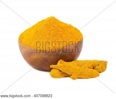 Dry Turmeric Powder In Wooden Bowl, Isolated On White Background. Curcuma Longa Linn.