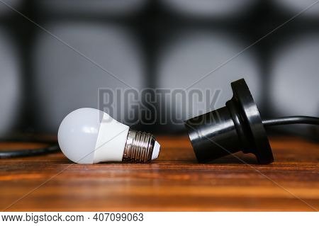 Unscrewed Lamp Near To A Cartridge For A Lamp. Lack, Power Outage. Electricity Is Not Supplied To Th