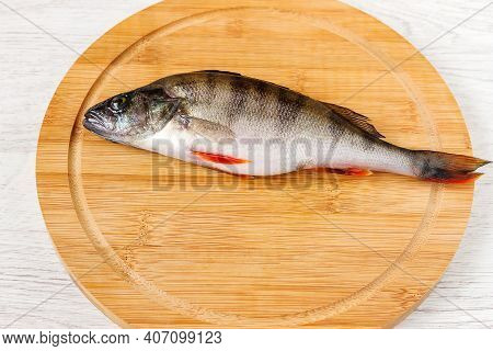 Freshly Caught Roach Fish Lies On A Cutting Wooden Board.