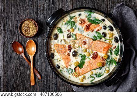 Tuscan Salmon Dish Of Pan-seared Skin-on Salmon Fillet With Cream Sauce, Garlic, Leek, Sun-dried Tom
