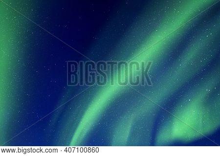 Night Starry Sky And Northern Lights. Green Aurora Borealis
