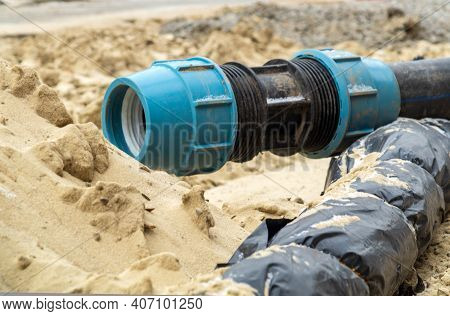 Closeup Of The Coupling For Hdpe Pipes On The Sand During Repair Work Of The Pipeline On The Constru