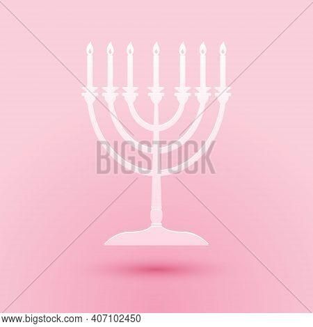 Paper Cut Hanukkah Menorah Icon Isolated On Pink Background. Religion Icon. Hanukkah Traditional Sym