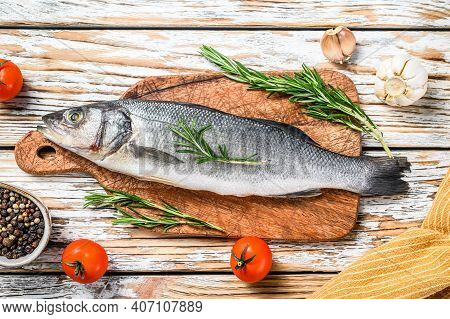 Sea Bass Fish With Herbs, Raw Seabass. White Background. Top View
