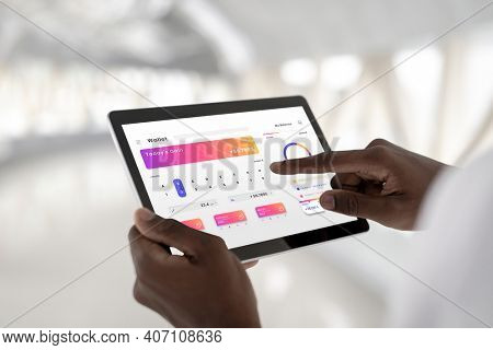 Man pointing and using a digital tablet