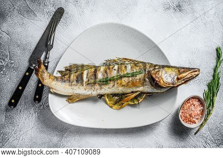 Grilled Zander, Walleye Fish With Herbs And Lemon On A Plate. Gray Wooden Background. Top View