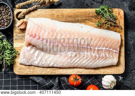Fresh Raw Cod Loin Fillet With Thyme. Black Background. Top View