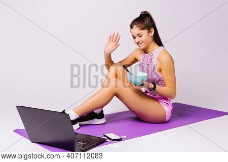 A Young Blogger Discuss In A Video Blog About Healthy Eating And Waves Smiling To Her Followers At T