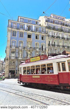 Lisbon, Portugal - 5 June, 2017: People Walking By The Tram Line In The Center Of The City. The Lisb