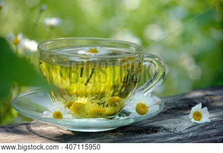 Cup Of Chamomile Tea On A Wooden Table. Herbal Tea. Cold And Flu Remedy.  Seletive Focus