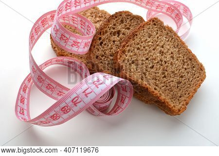 Slices Of Bran Bread With A Tape Measure, Ideal Bran Bread For Weight Loss,against Excessive Weight