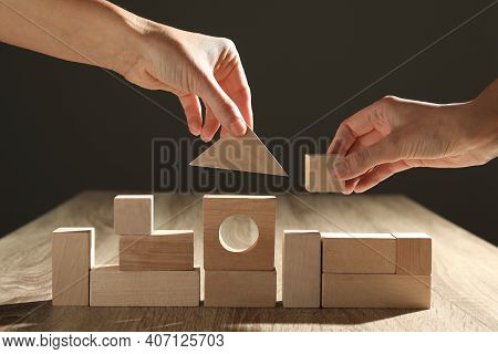 People Constructing With Wooden Building Blocks, Closeup. Corporate Social Responsibility Concept