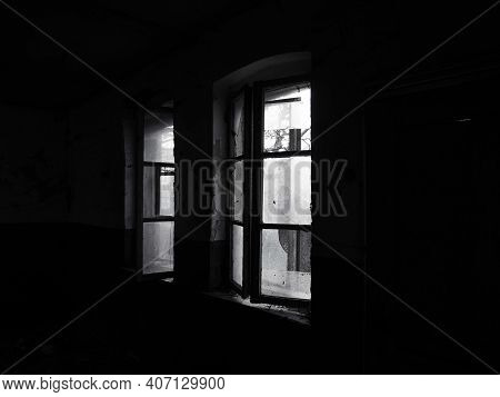 Scary Windows. Inside An Abandoned House. View Of Broken Windows Without A Curtain. Grunge Scene. Li