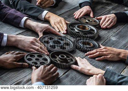 Business People Connect Gear Together At Meeting Table, Success Cooperation Teamwork Concept