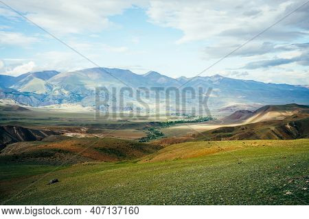 Awesome Vivid Mountain Landscape With Small River In Valley. Multicolor Mountains, Green Hills And C