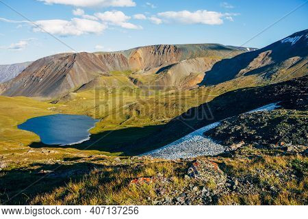 Wonderful View To Beautiful Mountain Lake And Mountain Range With Snow In Sunlight. Awesome Alpine L