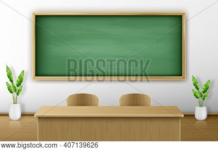 Classroom With Green Blackboard On Wall And Wooden Teacher Table With Chairs. Empty Chalkboard Backg