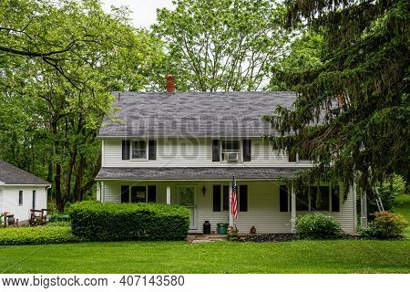 Penfield, New York, Usa - June 14, 2019: Typical American Residential House Building With American F