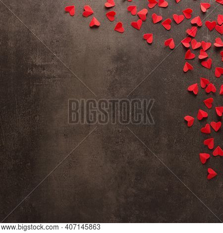 Many Bright Red Hearts On A Dark Background. Place For An Inscription. Valentine's Day. Top View