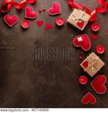 Romantic Valentine's Day. Postcard, Red Hearts, Candles And Romantic Mood On A Dark Background. Top