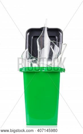 Household Waste Sorting Concept. Green Tank With Glass Waste Isolated On White Background