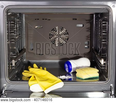 Household Homework. Cleaning A Dirty Oven. Gloves And Oven Cleaners