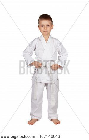 The Sport Is Karate. Serious Boy In White Kimono Isolated On White Background