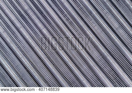 Tubes Of Cooling Radiator As Background. Top View. Bank Of Cells And Aluminum Tubes In Which Circula