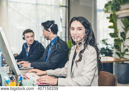 Beautiful Caucasion Women On Tele Marketing Representative Or Sales Agents Sitting At Workplace Wear