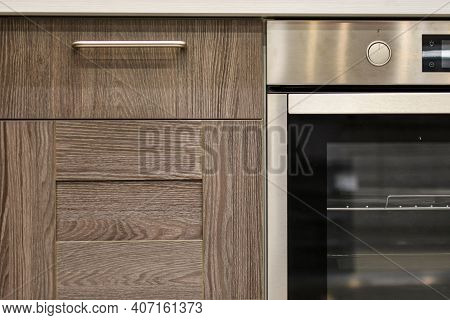 Kitchen Cabinet, Stove And Oven. Part Of Modern Kitchen Interior Close-up. Kitchen Cabinet Wooden Fa