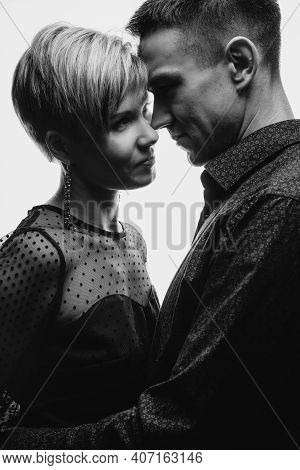 Delicate Close-up Portrait Of An Elegant Couple. Embrace Between A Man And A Woman. Bw