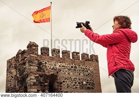 Tourist Woman With Camera Taking Travel Picture On Sohail Castle In Fuengirola, Malaga Spain. Touris