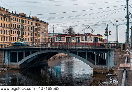 View Of The Novo-kalinkin Bridge Over The Obvodny Canal In Winter St. Petersburg. The Streetcar Cros