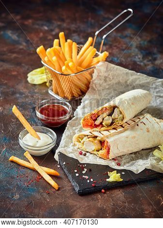 Eastern Traditional Shawarma With Chicken And Vegetables And French Fries With Sauces On Slate. Fast