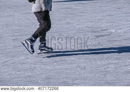 Closeup Of Legs Of Ice Skater On Outdoor Ice Rink In Montreal, Canada