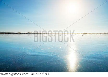 Sun In The Blue Sky Over A Frozen Winter Lake.. Fabulous Winter Landscape