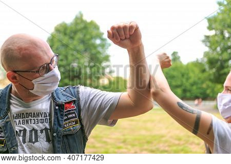 Minsk Belarus - August 27 2020: Elbow Bumping. A New Way Of Greeting To Avoid Of Coronavirus (covid-