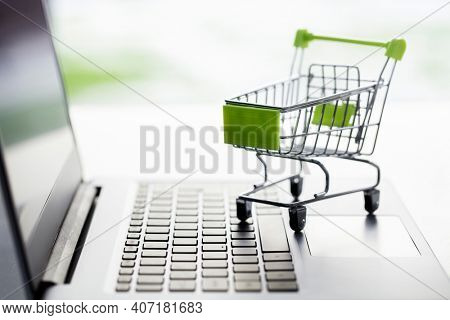 Shopping cart on laptop computer web store or shop concept for online shopping and delivery