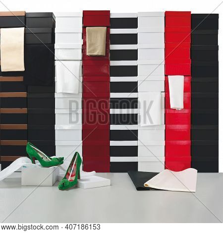 What Shoe Size Do You Need? Two Women's Shoes With Many Boxes With Many Different Sizes For Sale.
